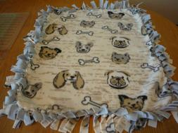 Handmade fleece tie blanket of dog faces for a small pet